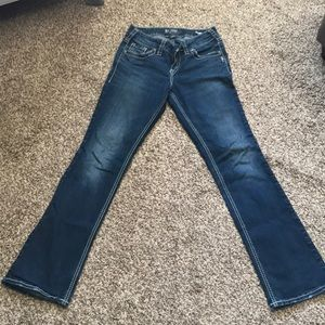 Like new silver suki slim boot jeans